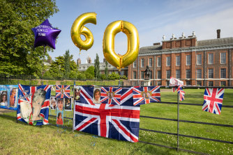 Flags, balloons and messages were left outside Kensington Palace to mark what would have been Diana's 60th birthday.
