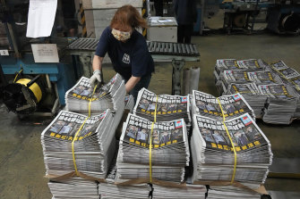 A worker packs copies of the Apple Daily newspaper at the printing house in Hong Kong.