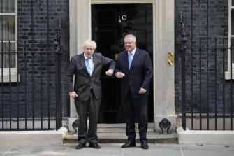 Britain's Prime Minister Boris Johnson greets Australia's Prime Minister Scott Morrison.