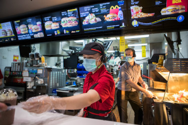 Maccas' staff to wear masks; More than 30 cases outside city's lockdown boundary