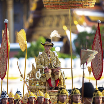 Thailand's King Rama X is carried through the streets of Bangkok during the second day of his coronation ceremony in 2019.