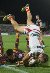Acrobatic: Jason Nightingale gets vertical to cross the stripe.