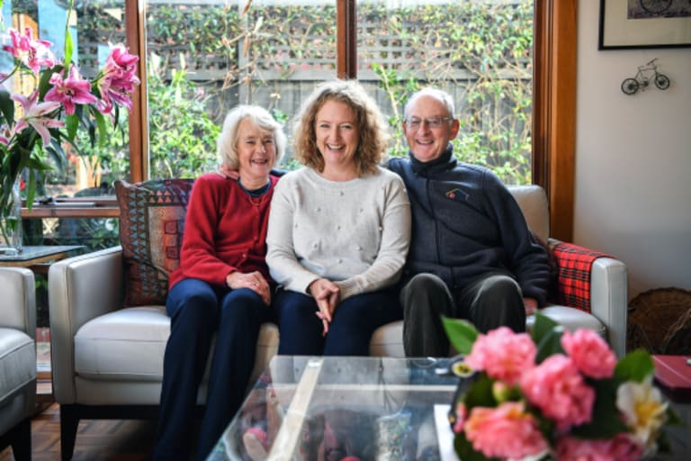 Proud of her: Sarah Rejman (centre) with her parents Sally and Adrian Wallis at the family's Malvern East home.