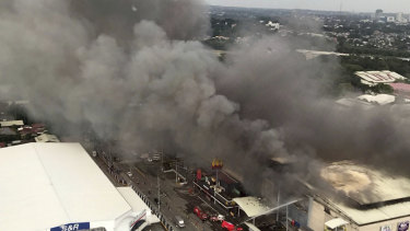 An aerial view of the fire, which raged for hours with people caught inside the shopping centre.