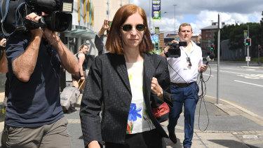 Suspended Queensland chief scientist Suzanne Miller leaves the Magistrates Court in Brisbane.