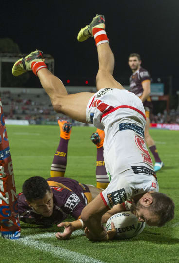 Acrobatic: Jason Nightingale gets vertical to cross the stripe.