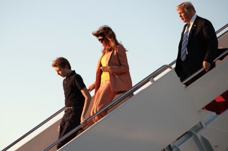 The US President, first lady Melania Trump and their son Barron Trump arrive on Air Force One at Palm Beach International Airport.