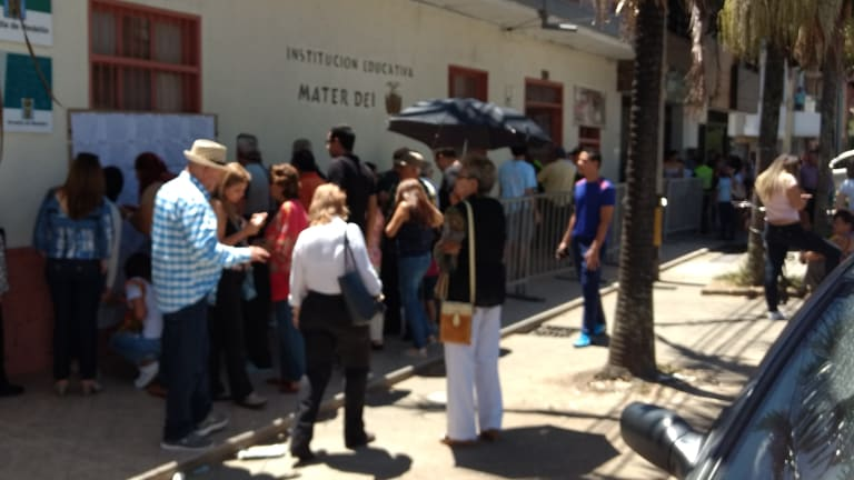 Voters queue up to vote in Colombian national legislative and presidential primary elections in Medellin, Colombia on Sunday 11 March.