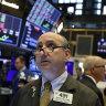 Wall Street slides as Apple, health shares drag, tariff deadline looms
