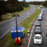 Queensland border opens early to deal with mass of waiting tourists