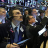 Wall Street ends higher as investors eye stimulus