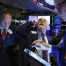 Wall Street gains as markets look to aid package; Nasdaq closes at record