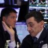 Wall Street slides lower on grim jobs report