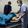 An Afghan receives treatment at hospital after suicide attack in Kabul, Afghanistan, Saturday, on October 24. The death toll from the suicide attack Saturday in Afghanistan's capital has risen that includes schoolchildren, the interior ministry said.