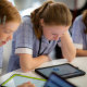 Hannah Crowe-Palmer and Meggie Boyle, in year 8 at St Scholastica's College, completing the first cyber security challenge.