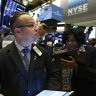 Wall Street slides from record highs after Fed minutes