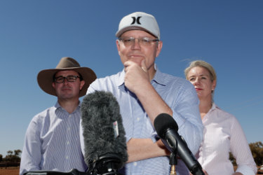 Prime Minister Scott Morrison (centre) speaks to the media as Minister for Agriculture and Water Resources David Littleproud (left) and Minister for Regional Services Bridget McKenzie look on during a press conference during a regional tour of the Tully property in Quilpie in south west Queensland, Monday, August 27, 2018.