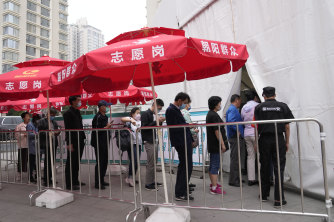 Residents line up outside a vaccination centre in Beijing this week.
