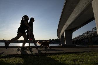 Locals exercise near Bridgewater Park, Rozelle.