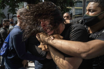 Plainclothes police detain an anti-government protester during a protest in Havana, Cuba, on Sunday.