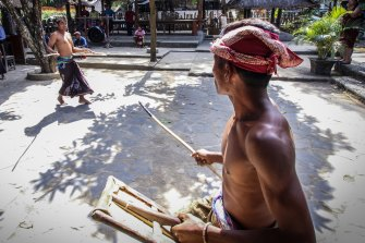 Sasak villagers stick fighting.