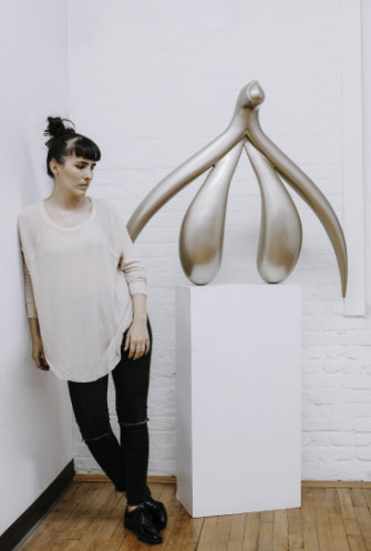 New York artist Sophia Wallace with her clitoris sculpture, Adamas (Unconquerable).