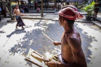 Sasak villagers stick fighting.