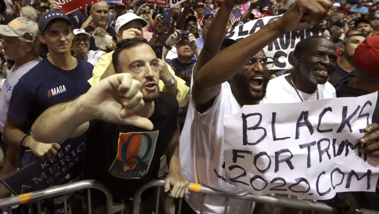 QAnon followers at Donald Trump's Tampa rally on Tuesday.