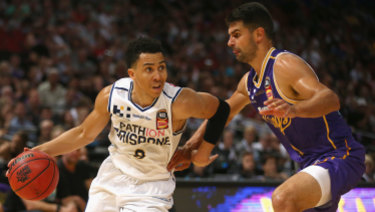 Travis Trice of the Bullets drives past Kevin Lisch of the Kings during the round 18 NBL match  at Qudos Bank Arena in Sydney.