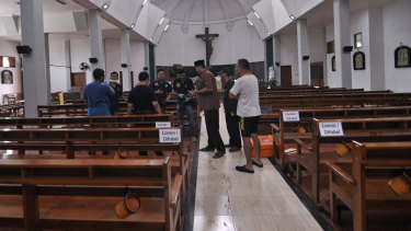 Blood stains the aisle at the Yogyakarta church.