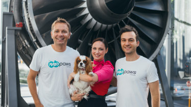 Mad Paws founders Jan Pacas and AlexisSoulopoulos with a Qantas staff member.