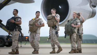 US Marines embark an aircraft at RAAF Base Darwin for their return home.
