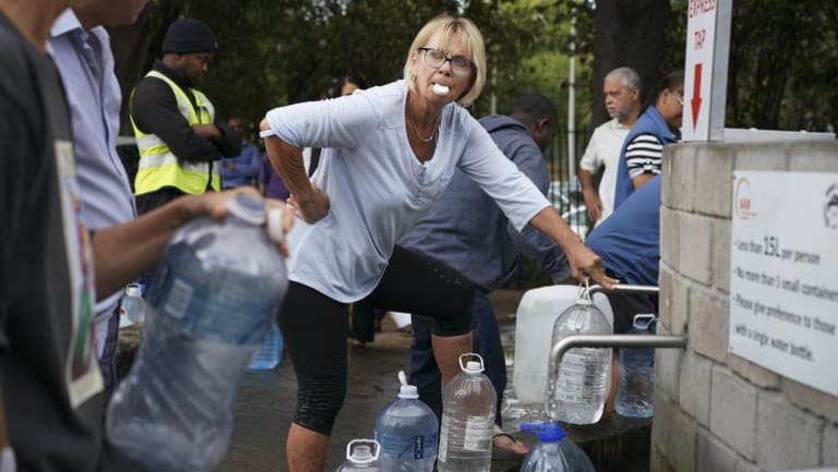 Residents collect water from a spring in the Newlands area of Cape Town.