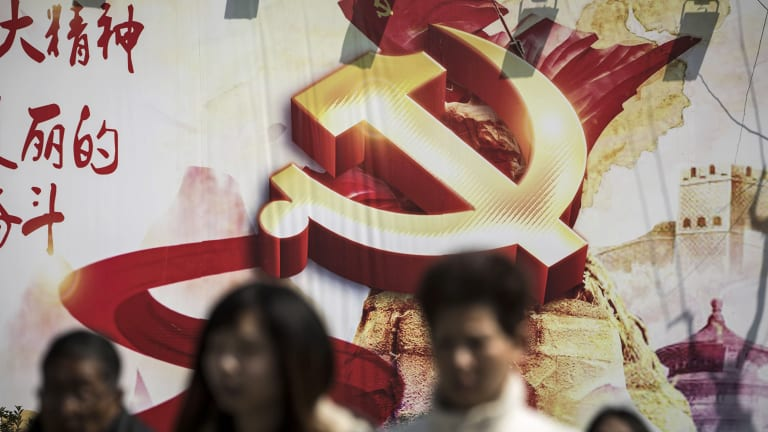 A banner featuring the hammer-and-sickle emblem is displayed in Shanghai, China.