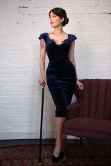 "Tara Moss with ""Wolfie"", her walking stick."