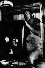 Pan American cargo handler Gary Hatch, who found stowaway Brian Robson, shows just how squeezed he must have been.