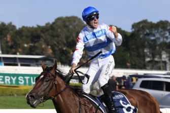 Tommy Berry stands tall in the irons after Stay Inside's dominant win in the Golden Slipper.