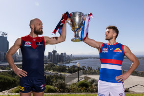 Max Gawn of the Demons and Marcus Bontempelli of the Bulldogs pose with the 2021 AFL Premiership Cup in Perth, ahead of the grand final on Saturday.
