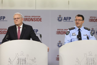 Prime Minister Scott Morrison and AFP Commissioner Reece Kershaw discuss the mass raids and arrests  following a long-running law enforcement operation.