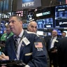 Wall Street rebounds from early slump but finishes lower