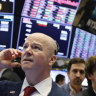 Wall Street edges up in volatile trade day