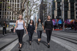 Rachelle Kells, Simone Coburn, Cecilia Palmero and  Victoria Day walking to work in the city to avoid using public transport.