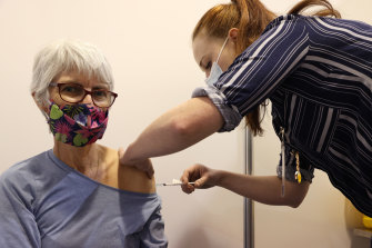 Nurse Sioban Cheesman gives Angela Massie her AstraZeneca COVID-19 vaccine in Perth earlier this month.