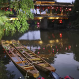 Two dragon boats that capsized sit in the water on the Taohua River in Guilin.