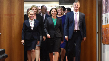 New LNP leader Deb Frecklington (centre) and her new deputy Tim Mander (right) walking in to the party room meeting that saw their elevations.