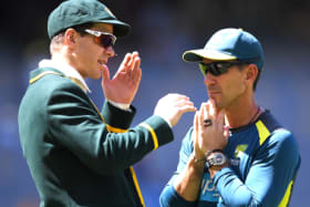Toss up: Justin Langer looks to captain Tim Paine after Australia elected to bat – and change dressing sheds – in Perth.