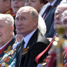 Putin fronts showy military parade ahead of key power vote