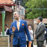 Michael Garofolo auctions off a house in Concord, Sydney, on Saturday.