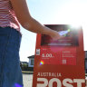 AusPost invites volunteer parcel deliveries while executives eye bonuses