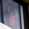 Tennis players bang on the window while in quarantine at View Melbourne hotel.